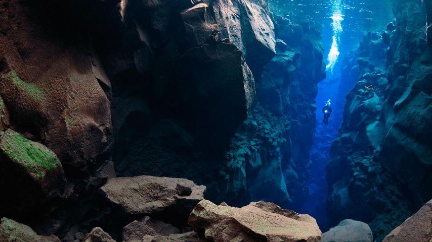 Diver in the Silfra, Thingvellir Lake, Thingvellir National Park, Iceland