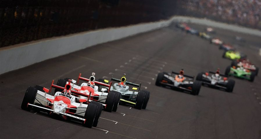 Cars racing on Indianapolis Motor Speedway in Indianapolis, Indiana