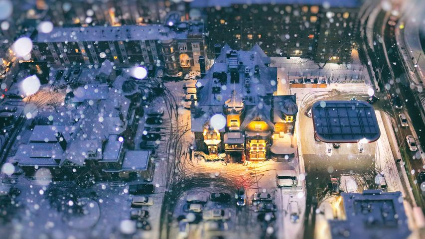Aerial view of a residential area on a snow day during blue hour, Toronto