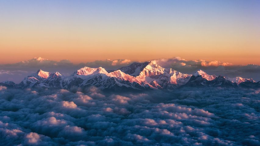 Kanchenjunga, on the India-Nepal border, among a sea of clouds at sunrise