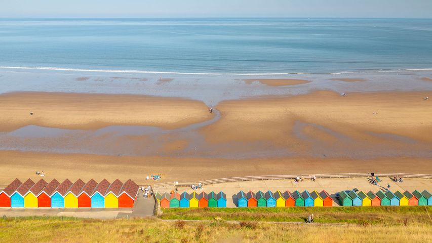 Beach huts on West Cliff Beach, Whitby, North Yorkshire