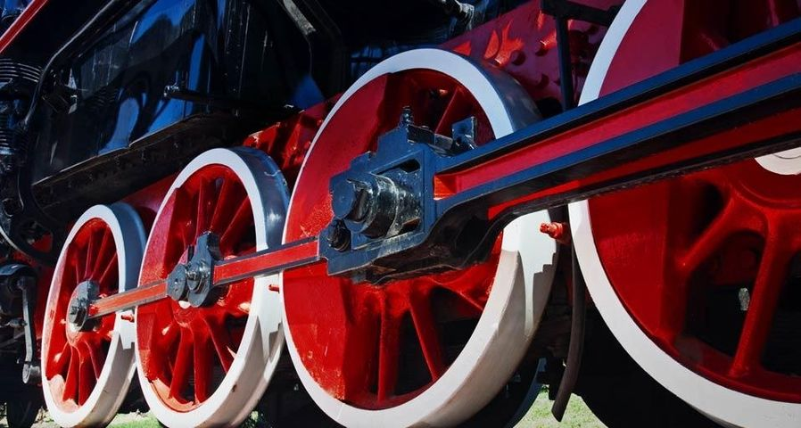 Red wheels of steam train
