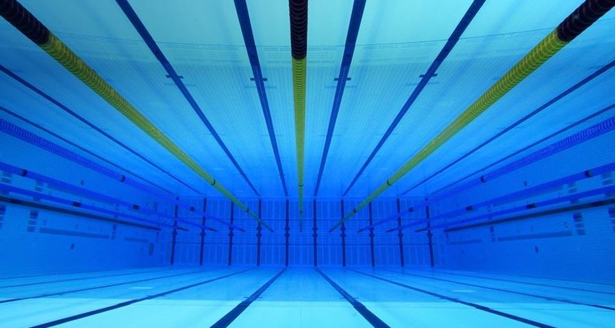 Swimming pool at the Aquatics Centre in the Olympic Park in Stratford, London, England