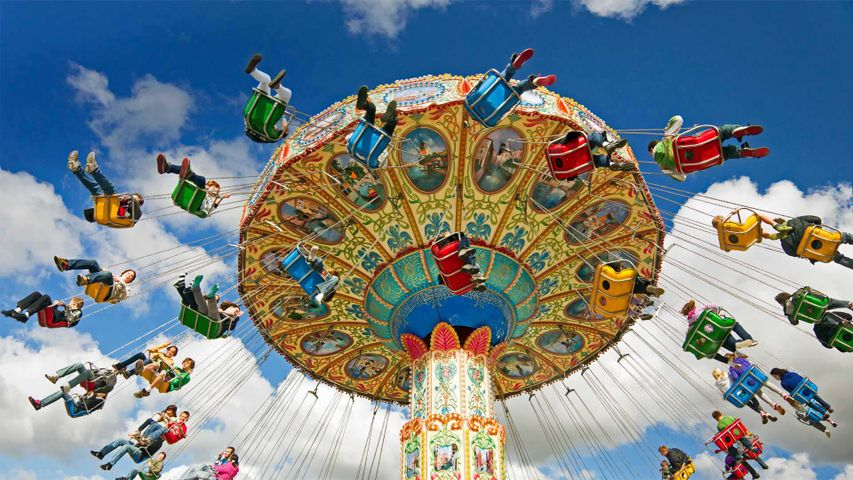 People on a swing ride at a carnival