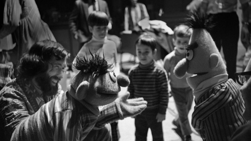 Jim Henson, along with Ernie and Bert, rehearses for an episode of 'Sesame Street' in 1970 in New York City