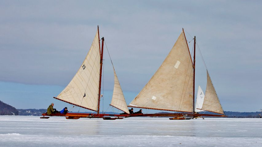 Antique iceboats on the frozen Hudson River near Astor Point in Barrytown, New York, USA