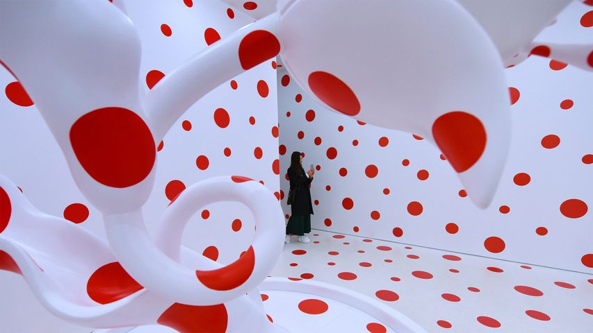 A woman looks at Yayoi Kusama's 'With All My Love for The Tulips, I Pray Forever (2011)'