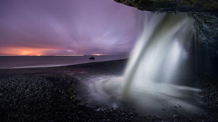 View of a waterfall at Mystic Beach in Juan de Fuca Provincial Park, B.C. during dusk