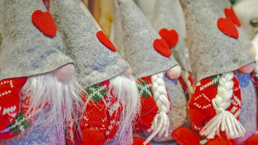 Gnomes for sale at a Christmas market in Pergine Valsugana, Italy