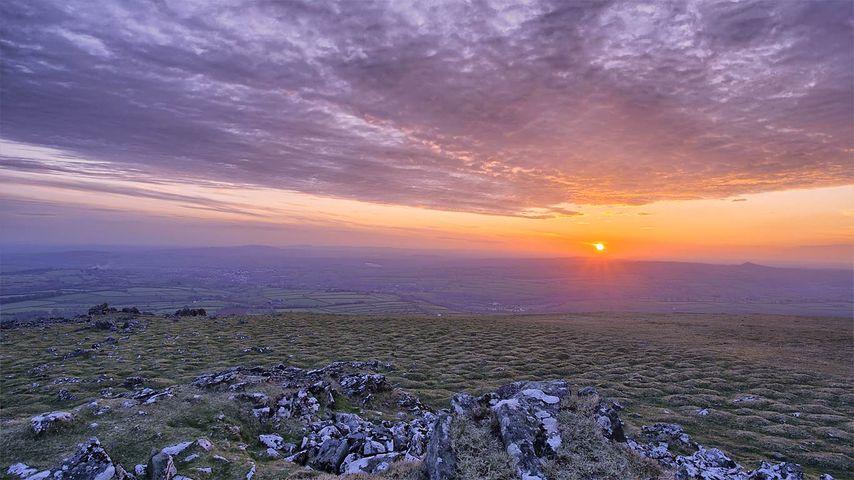 Sun setting in Dartmoor National Park, Devon