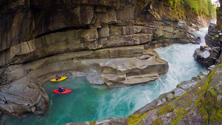 Kayakers in Ashlu Creek near Squamish, British Columbia, Canada