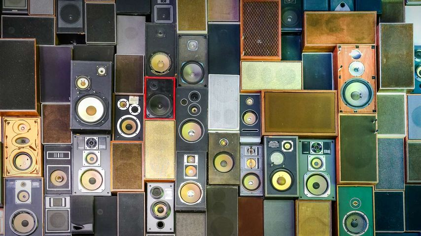 Retro music speakers hanging on a wall