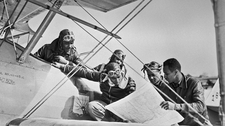 Tuskegee Airmen reading a map