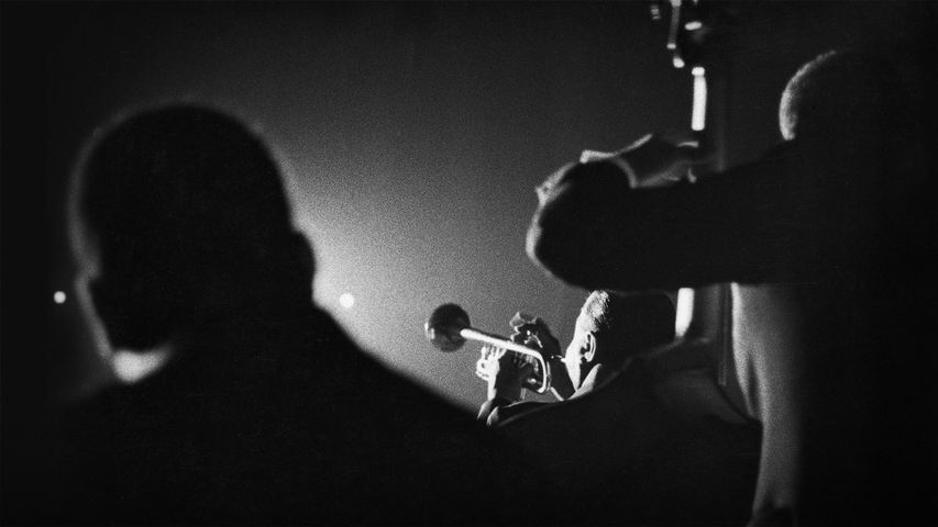 Louis Armstrong performs with bandmates in Vienna, Austria, on February 22, 1959