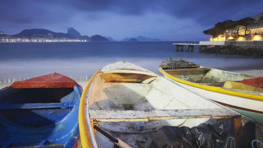 Fishing boats on Copacabana beach at dusk, Rio de Janeiro, Brazil