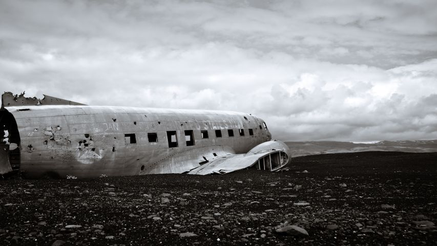 plane sky outdoor airplane ground cloud transport black and white