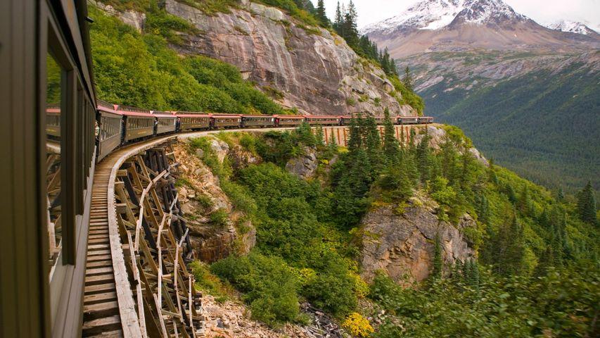 mountain outdoor train tree railroad bridge vehicle traveling