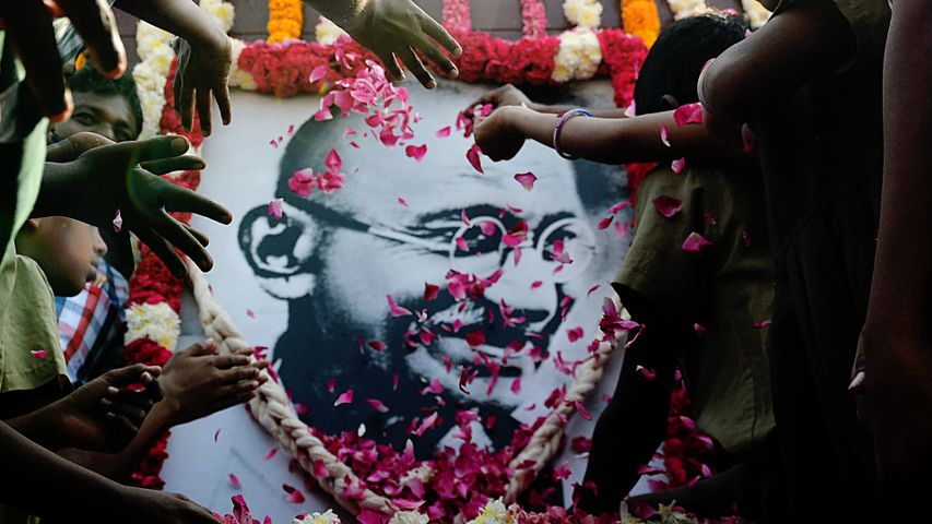 School children pay homage to a portrait of Mahatma Gandhi on Martyr's Day.