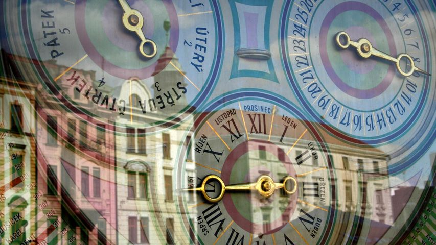 Buildings reflected in the astronomical clock in the Upper Square of Olomouc, Czech Republic