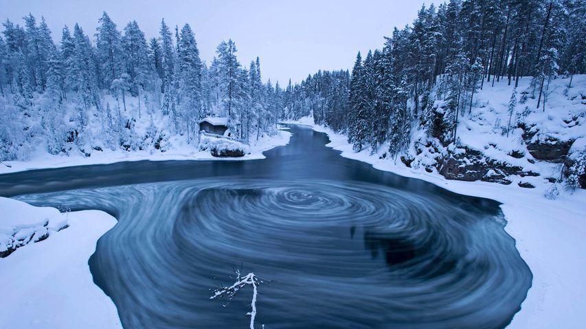The whirlpool in Myllykoski scenic area at winter in Oulanka National Park, Kuusamo, Finland