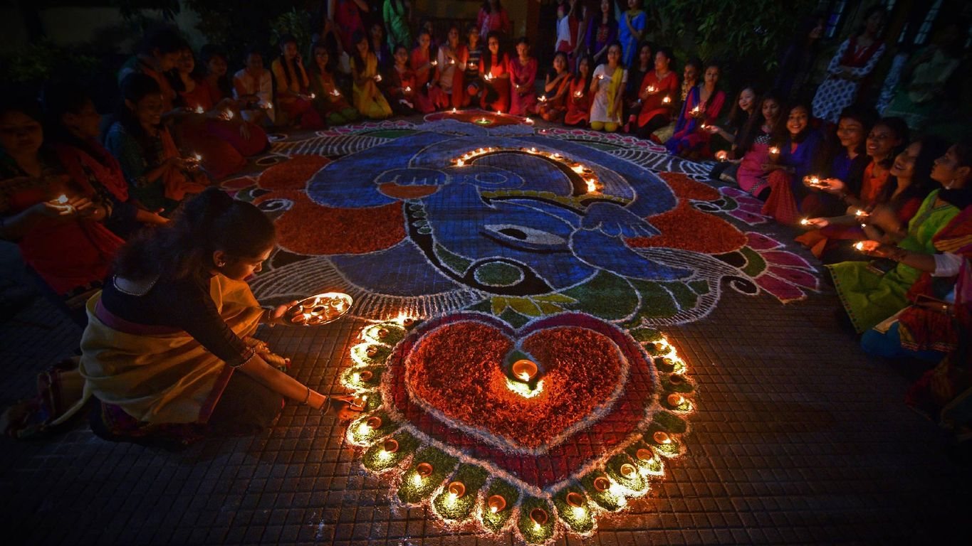Students light oil lamps to celebrate Diwali in Guwahati, India