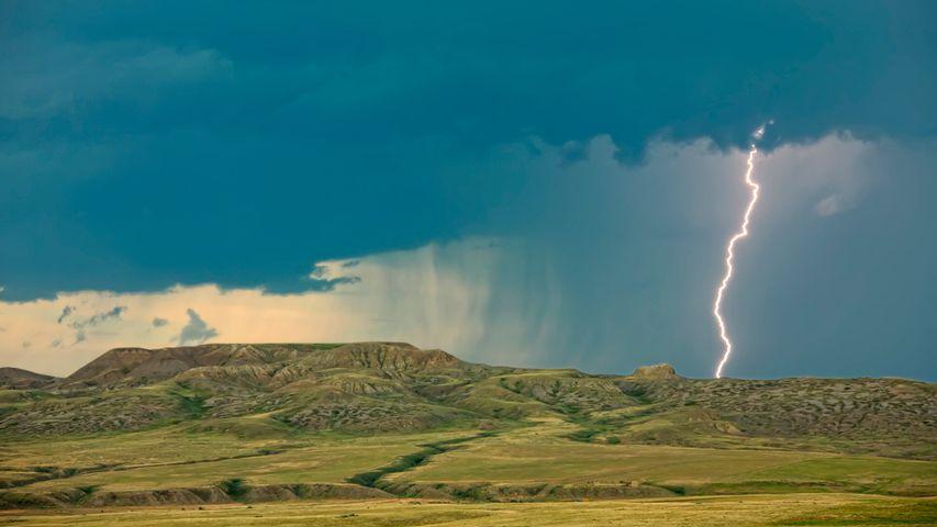 Lightning striking over 70 Mile Butte and Sleeping Lion Butte, Grasslands National Park, Saskatchewan