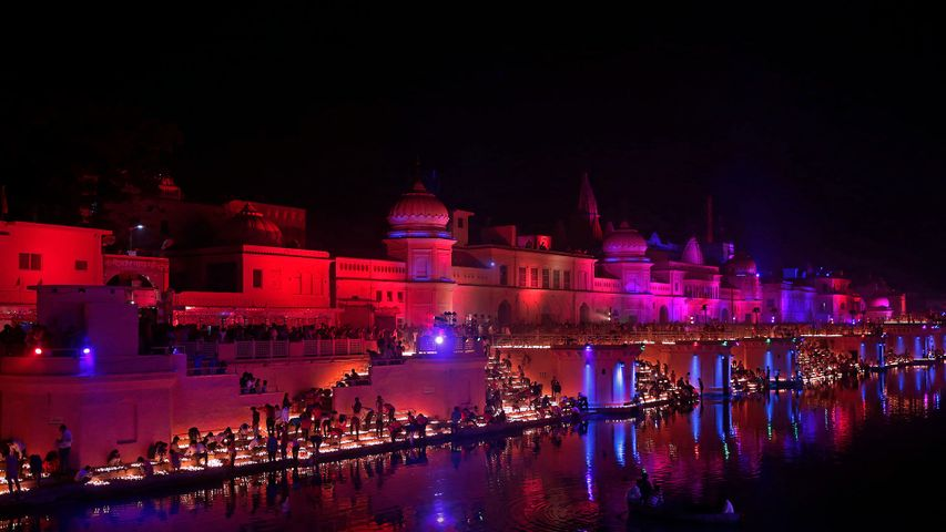 Devotees light oil lamps on the banks of the Sarayu River in Ayodhya, India