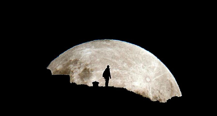 Perigee moon rises over Mt Eden in New Zealand's largest city of Auckland