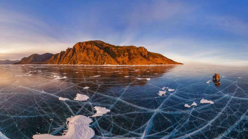 Aerial view of car crossing over the frozen surface of Lake Baikal, Russia
