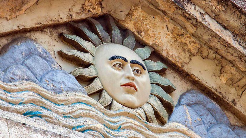 Sun deity on arch of Parsi Fire-Temple, south Mumbai