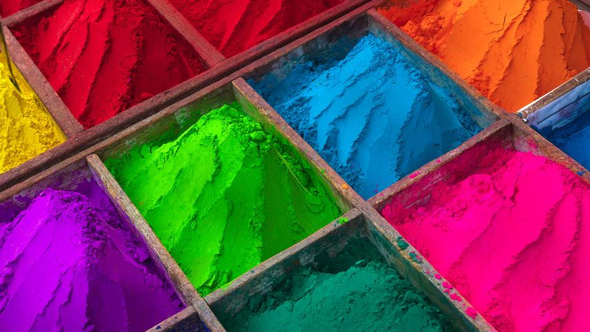 Brightly colored powder for sale during Holi