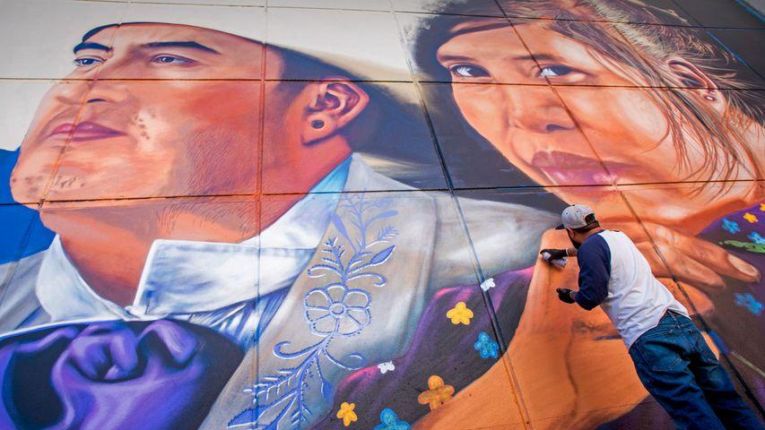 Artist Jesus 'CIMI' Alvarado painting his mural 'Fronterizos' on a wall of the El Paso Museum of Art, El Paso, Texas