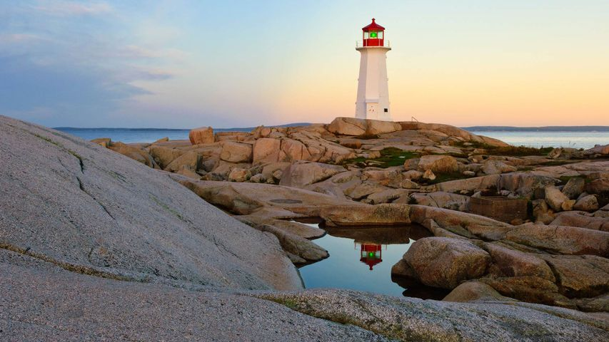 Lighthouse reflected in a pool of water at Peggy's Cove, N.S.