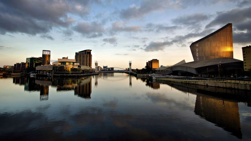 The Lowry Theatre and Imperial War Museum North, with reflections at Salford Quays, Greater Manchester