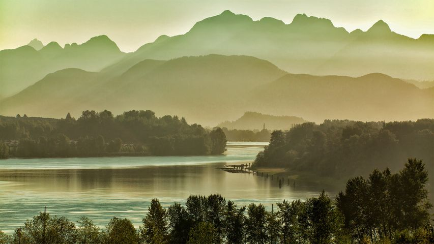 The Fraser River, east of Vancouver, British Columbia, Canada, with the Golden Ears mountains
