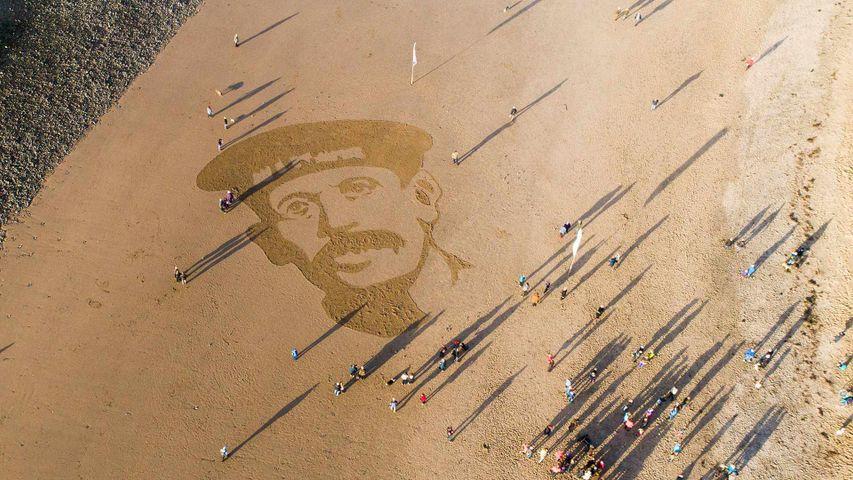 Sand portrait of WW1 Royal Naval Reservist Richard Davies on Ynyslas Beach, Ceredigion