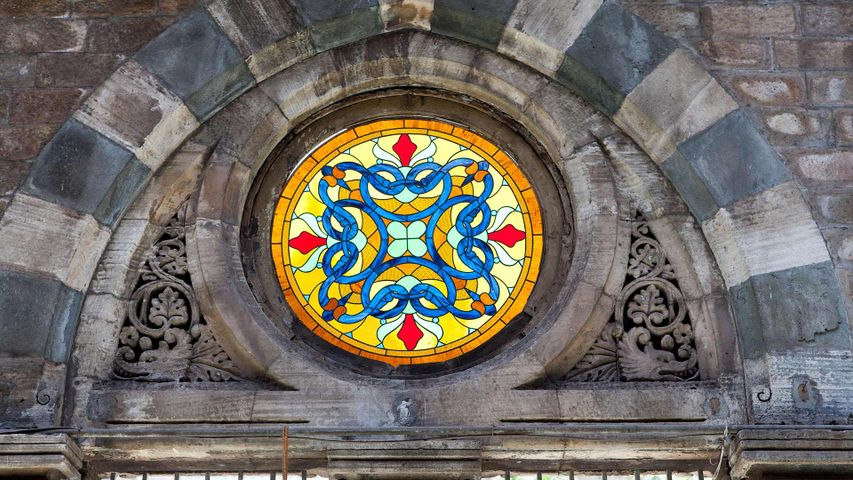 Colourful stained-glass window at the CST railway station (earlier Victoria Terminus), Mumbai