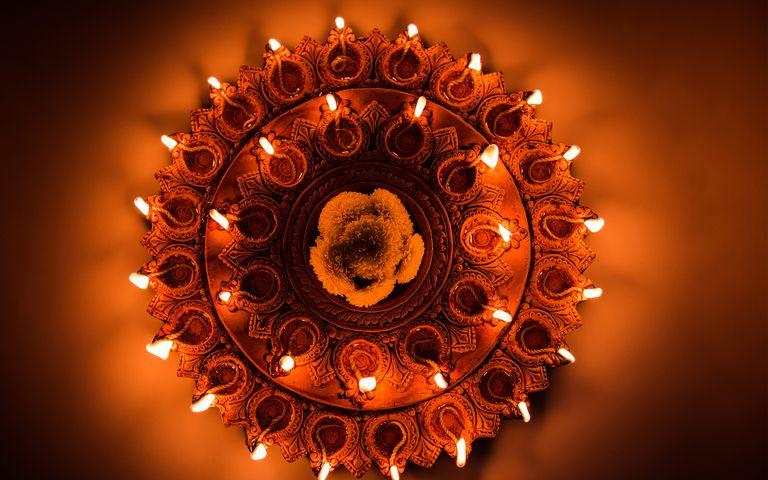 candle light gold lit lighting dark gear