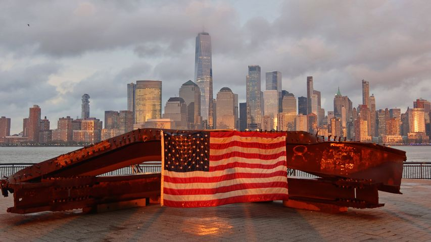 US flag on part of a 9/11 memorial overlooking the New York skyline from Exchange Place, Jersey City, New Jersey