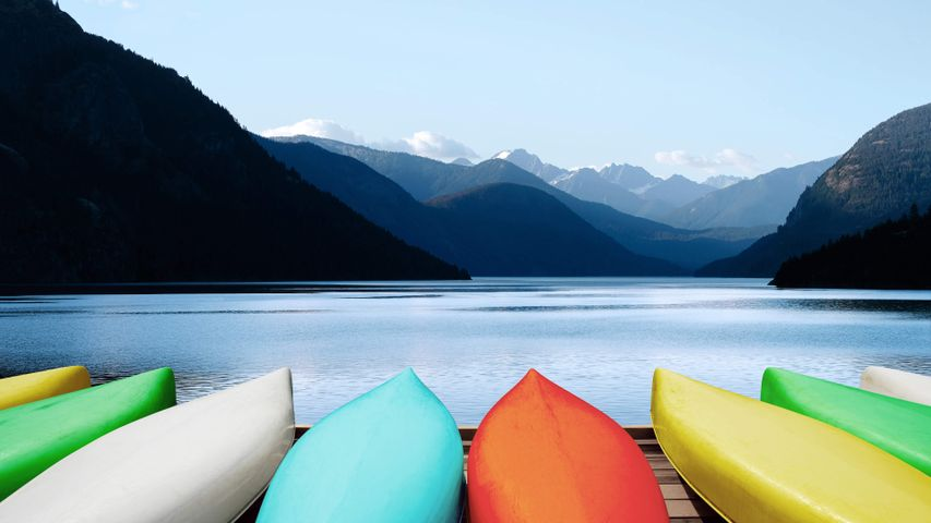 mountain sky lake water boat watercraft green
