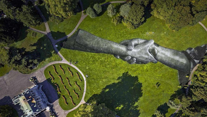 Artist Saype's 'Beyond Walls' installation in the Parc de la Grange, Geneva, Switzerland