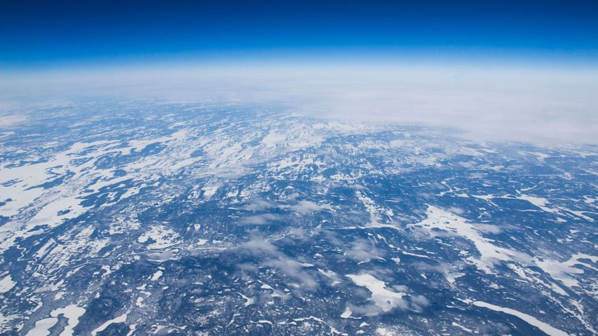 snow outdoor sky plane nature window aerial covered