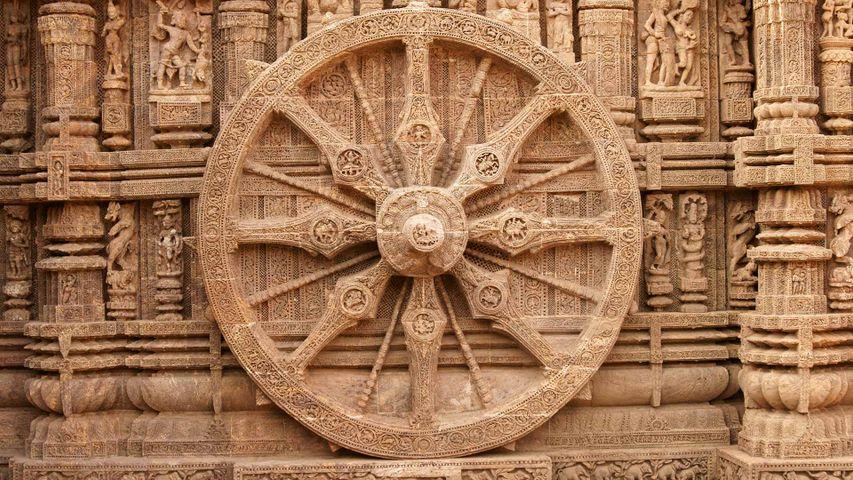 A stone wheel engraved in the walls of the Konarak Sun Temple in Orissa, India