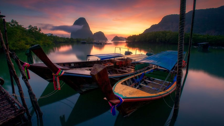 water sky outdoor boat watercraft mountain ship sunrise