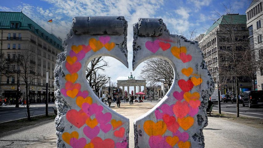 The Brandenburg Gate seen through a heart-shaped replica of a remnant of the Berlin Wall