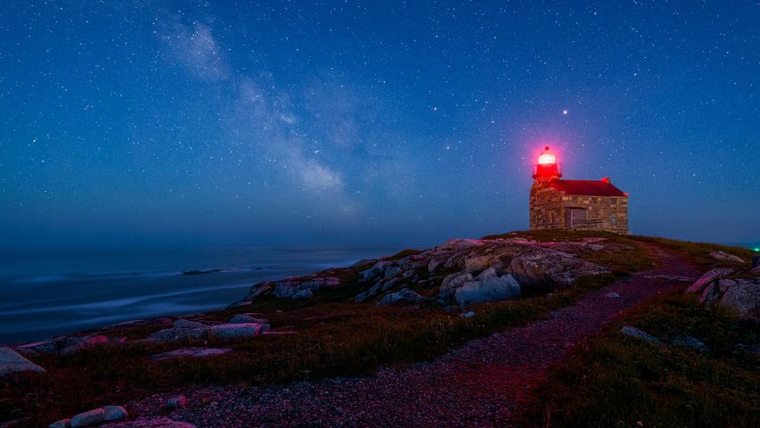An old lighthouse under the starry sky in Rose Blanche, Nfld.