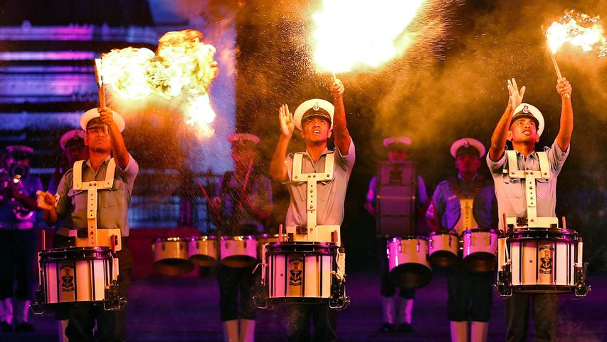 Indian Navy soldiers demonstrate their skills as they play drums during a rehearsal ahead of Navy Day