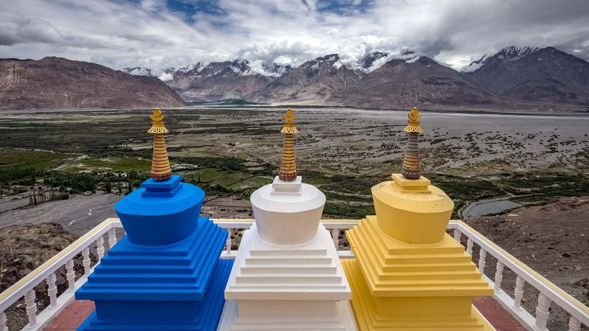 Three stupa with Nubra Valley in the background in Ladakh, India
