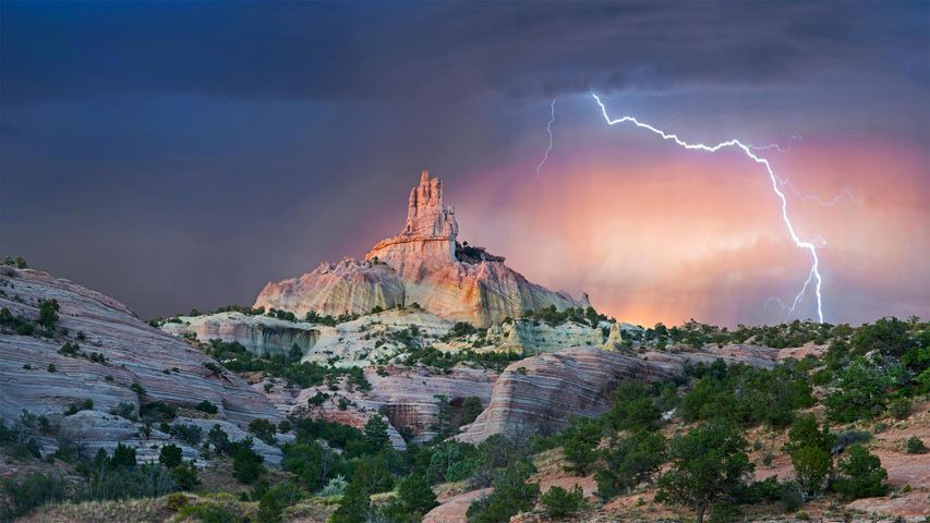 Lightning strikes near rock formation, Church Rock, Red Rock Park, New Mexico, USA