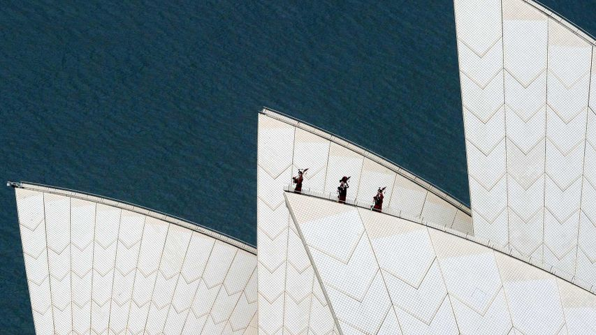 Royal Highland Fusiliers playing the bagpipes on top of the Sydney Opera House
